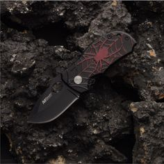 Red Spider Mini Knife  We hope you don't have a fear of spiders or you'll miss out on this great liner lock. MTech brings you this 440 stainless steel knife with a baked on custom epoxy finish and aircraft grade aluminum scales that features a cool spider. Be a hero in every day tasks. This mini Spider knife has black scales with a red spider and a wire pocket clip.