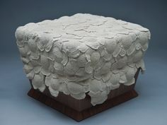 Monomoka Modern Furniture... Blossom... A wooden stool covered with a tablecloth made up of 140 crocheted cotton cord flowers on a trapezoidal base made of American walnut.