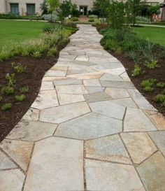 Cut flagstone walkway with small gaps (about 1 inch). That makes this walkway fairly formal for walking on, yet the edges have been cut to blend into the beds that line them.