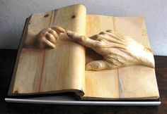 A sculpture by Nino Orlandi, a wood sculptor with a great imagination and a passion for books