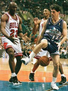 Hall of famers Michael Jordan, Scottie Pippen, and John Stockton scramble for a loose ball during a finals game in Chicago.
