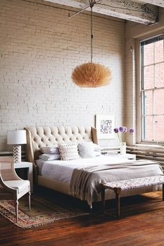 Meet The Only Table Style You'll Ever Need// warm industrial bedroom design with tufted headboard