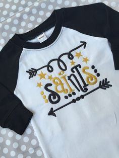 A personal favorite from my Etsy shop https://www.etsy.com/listing/468491738/football-team-baby-gown-saints-football
