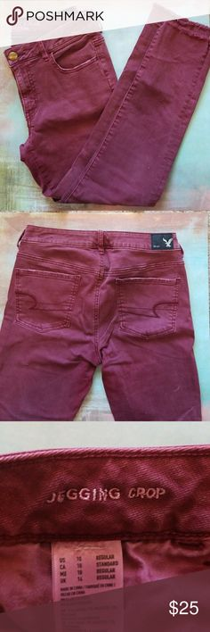 "AE maroon jeggings In great condition! Super stretchy maroon jeggings from American eagle. They are cropped, and hit just below ankle length on someone 5'2"".  Frayed hem. Bundle for a discount! American Eagle Outfitters Jeans Ankle & Cropped"