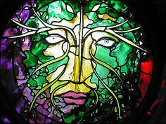 Green Man (summer) by John Piper. Stained glass windows in the Ipswich School Library gallery. The theme of the Green Man is represented through the four seasons, the four elements and the ages of man.