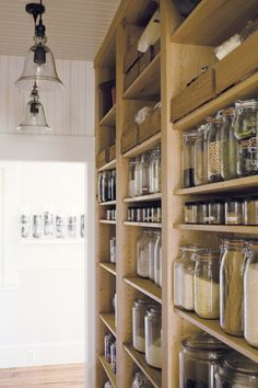 Pantry of dreams. I've always wondered what I could do with all my spices in jam jars if I had a choice rather than shove them in the tiny cupboard I have now. I want to build a house just so I can have this.