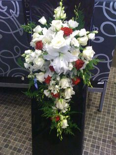 Looking for a bouquet that creates a lasting impression? Contrasting accent colours like the red on this mainly white cascading bridal bouquet look great on the day and in photos. We'd love to discuss your requirements for your big day with you, give us a call on 0161 861 0524. #wedding #weddingflowers