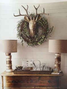 Wreath, white wall, antlers Horchow
