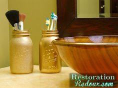 Spray painted mason jars as bathroom storage