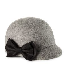 Hat $12.95    Felt hat with a small brim at front and a bow at side.