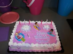 Lego Friends added to a pink/purple cake!  Perfect!