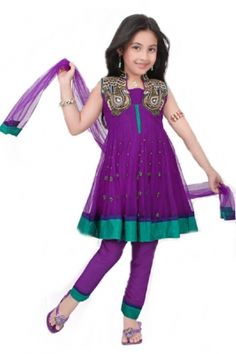 This is a beautiful Purple Kids Anarkali Suit with fancy beadwork and with a matching churidar bottom and dupatta. Wear this sleeveless or with sleeves that can be stitched on if so desired.