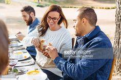 Foto de stock : Couple breaking bread at outdoor table