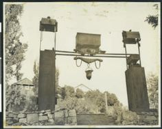 View of Angel's Camp in Utica Park, showing a mining cart suspended above the ground, ca.1930 :: California Historical Society Collection, 1...