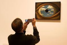 New York City. 2005. The Museum of Modern Art. Man photographing a Magritte's painting. by  Thomas Hoepker