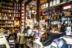 Mercado San Miguel, Madrid: vendors serving customers Royalty Free Stock Photo
