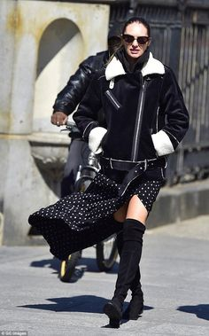 Candice Swanepoel wearing Stuart Weitzman Lowland Suede Boots, Krewe Josephine Sunglasses in Black and Blanknyc Down & Out Jacket