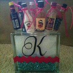 21st birthday gift...10 mini alcohol bottles glued onto kabob sticks. You can place them into any sort of container. Creative and fun!!