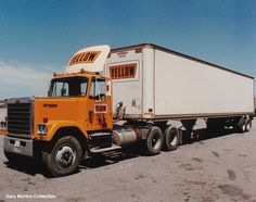Yellow Transportation Chevrolet Bison pulling a smooth side trailer.
