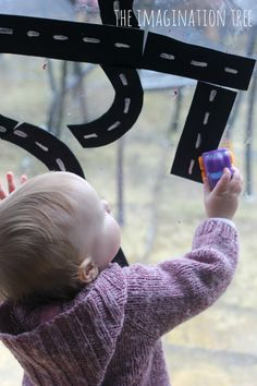 Craft foam + water + cars = hours of fun playing on the window! (great for gross motor skills development too!)