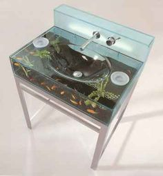 Aquarium sink. This is nuts! How would the fish survive cold and hot water changes? how do you clean it? uuuhhhh I hate cleaning fish tanks never mind fish sinks. lol Its still cool though.