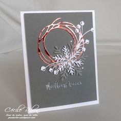 Snowflakes and swirly bird make a pretty Stampin' Up! Christmas card
