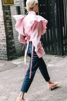 Photo via: Vogue Spain Thanks to this street style outfit, we've been on the hunt for the coolest pink statement tops of the moment. Think ruffles, flared sleeves, and other fun details. Get the look: