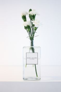 Perfume bottle turned into a vase.