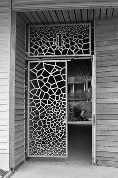 white lasercut panel | One of several unique entrances to the Koggens gränd housing block