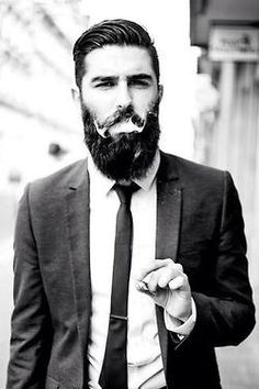 Smoking with beard and suit super cool hey ladies ?