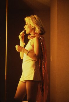 Singer Debbie Harry at the mirror backstage, Las Vegas, Nevada, United States, 1979, photograph by Roberta Bayley.