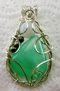 Pendant $47.97 ~ Beautiful Green Paraiba Calsite, Rainbow Moonstone, and Pyrite Gemstones hand sculpted in the finest Jeweler's Sterling Silver in a unigue designed setting copyrighted by Elizabeth DeVigili. Lightweight and easy to wear. Measures about 1 1/2 in le...