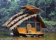 A floating room with a thatched roof