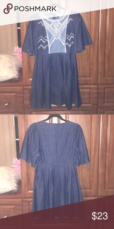 Jean dress xo Unique Jean-brunch dress, all sorts of patterns on the front! This is a fun one and I'm sure no one else will have it 👏🏽 flows sleeves, working zipper in the back. NEVER WORN 😃not FP Free People Dresses Midi