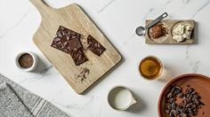 """Packaging for Beau Cacao by Socio Design """"We were invited to design the packaging for Beau Cacao and their first two bars, Asajaya and Serian. Our geometric gold foiled pattern was inspired by traditional Malaysian fabric designs, and reflects the..."""