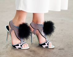 Sophia Webster pom-pom printed heels are worn with a white maxi skirt