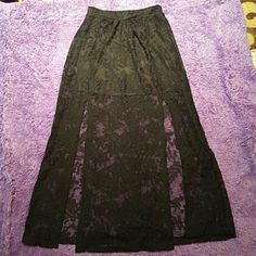 Lily white Long black skirt $9 Very cute skirt, only selling it because it fits too tightly now. LIKE NEW, no stains, or tears. Size XS-SMALL Lily White Skirts High Low