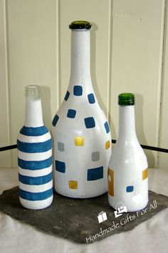 A great way to recycle those wine bottles and a great excuse to buy more wine!  Hand painted bottles are ideal dinner candle holders, vases or like this gorgeous trio, ornaments.