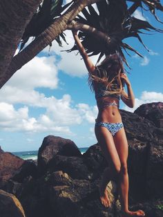 Mimi Elashiry in the Tile print 'heartbreaker' bottoms and 'sandy' cross top from www.campcoveswim.com