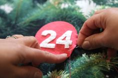 looking at this pic, i had the thought to make a christmas tree into an advent calendar with ornaments...a full size tree