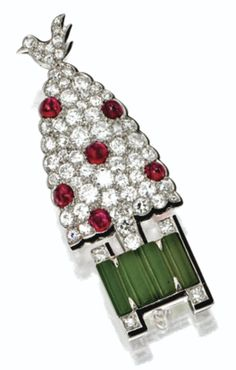 An Art Deco diamond, ruby and nephrite topiary brooch, Cartier, circa 1930. Designed as a tree with a bird perched on top, pavé-set with old European-cut and single-cut diamonds and studded with round cabochon rubies, the base decorated with four cylindrical segments of nephrite, all edged in black enamel, mounted in platinum, signed Cartier, numbered. #ArtDeco #Cartier #brooch