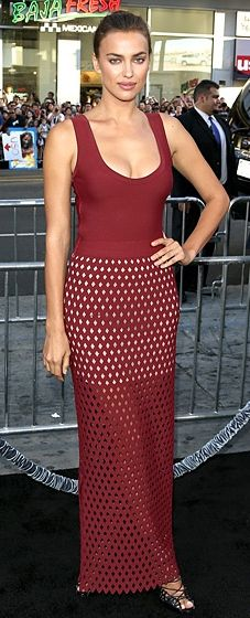 """Irina Shayk wore a ruby Azzedine Alaia dress with a laser-cut semi-sheer skirt to the """"Hecules"""" L.A. premiere."""