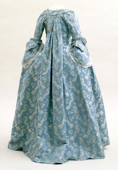 the rear view of a blue damask gown (circa 1760) on display at the Indianapolis Museum of Art ©
