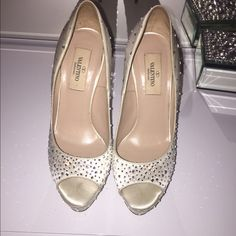 Valentino Shoes! Bridal/Party shoes! This gorgeous pair was used as a wedding pair; however because of the photoshoot at the park, the heels are all scratched and dirty. Can be easily changed by any show repair shop. Was worn only once on the wedding day. Valentino Shoes
