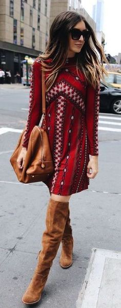 Red print dress with tan handbag and OTK boots.