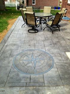 Stamped concrete patio with compass design