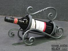 Postolje za flasu. Kovano gvozdje Kolacek 1897. Wine bottle stand. Wrought Iron. Kolacek 1897.