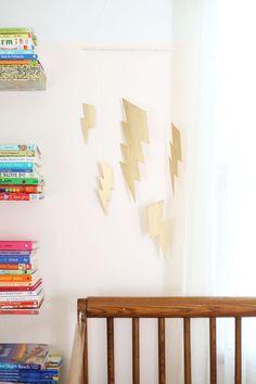 Easy DIY metallic lightning bolt mobile. Nursery Themes, Room Themes, Harry Potter Nursery, Cool Kids Rooms, Diy Art Projects, Love Your Home, Beautiful Mess, Lightning Bolt, Kids Decor