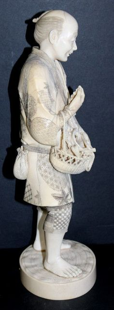 """Antique 19th C. Japanese Ivory Okimono Figure. Measures - 12 1/2"""" high x 4 1/2"""" wide, weighs - 1,420.4 grams."""