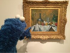 Cookie Monster admires a Cezanne during his visit to NYC museums: MoMa, Guggenheim, the Metropolitan Museum #CookieArtTour